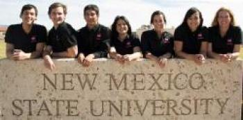 Image of group next to NMSU sign