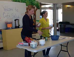 Image of Eloisa Mena and Cheryl Neeley, 2013 Class Interns performing a nutrition class at Casa de Peregrinos .